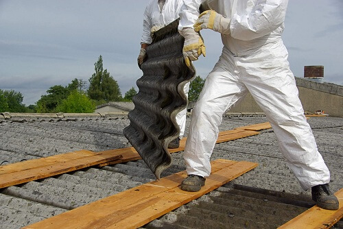 Builders laying corrugated sheet